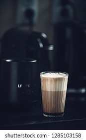 caffe latte at home in the kitchen with milk foam