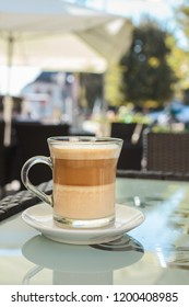 Caffe latte on a glass table