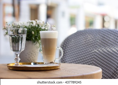 Caffe Latte on a table of a cafes terrasse