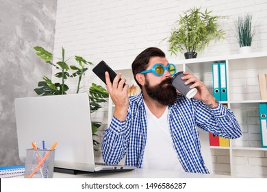 Caffeine influence. There is always talent shortage. Man freak crazy manager having phone call while drinking coffee. Freak managing projects. Office freak. Weirdo at workplace. Toleration of weirdos.
