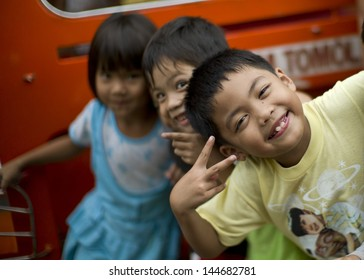 CAGAYAN DE ORO, PHILIPPINES - DEC 20: Unidentified children were playing with relief team in a village in Mindanao which was hit by storm Sendong on December 20, 2011 in Cagayan de Oro, Philippines.