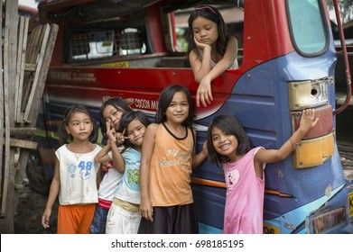 CAGAYAN DE ORO, PHILIPPINES - DEC 20: Unidentified children are playing in a bus in a village in Mindanao which was hit by storm Sendong on December 20, 2011 in Cagayan de Oro, Philippines.