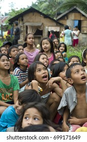 CAGAYAN DE ORO, PHILIPPINES - DEC 20: Unidentified children  are smiling to the relief team in a village in Mindanao which was hit by storm Sendong on December 20, 2011 in Cagayan de Oro, Philippines.