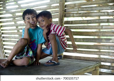 CAGAYAN DE ORO, PHILIPPINES - DEC 20: Unidentified children are making fun to each other  in a village in Mindanao which was hit by storm Sendong on December 20, 2011 in Cagayan de Oro, Philippines.