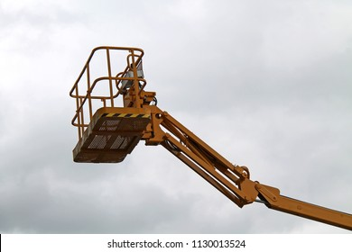 The Cage and Arm of an Hydraulic Lift Cherry Picker.