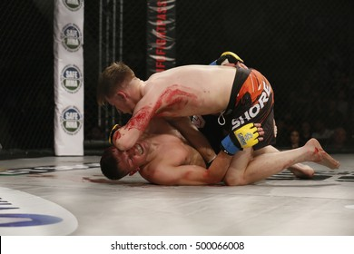 Cage Warriors 79 Newport Leisure Centre, Gwent, Wales. UK. October-15-2016 Eddi Pobivanez (Get) v Jack Shore Red Flash on shorts (Wales) Shore strikes Pobivanez with his elbow.