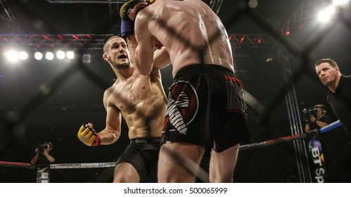 Cage Warriors Wales  Newport Leisure Centre, Newport, Gwent, Wales. UK. October-15-2016 Martin Sheridan (Ireland) v Josh Reed (Wales) 135lbs , Reed  Punches out towards his opponent.