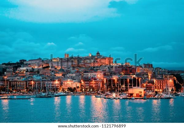 Cagliari cityscape and architecture with Mediterranean Sea on Sardinia island, Summer Italy