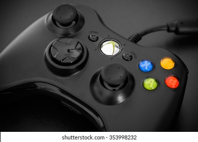 Cagliari - December 20, 2015: Close view of the Microsoft Xbox 360 Controller on black background.