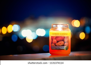 Cagliari, Italy 10/07/2018; Yankee candle big jar at night with lights bokeh in background