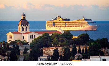 Cagliari, Italy, 10/10/2017 ; MSC Splendida cruise ship arriving to Cagliari and passing in front of Basilica of Our Lady of Bonaria