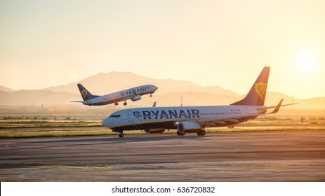 Cagliari, Italy 1-5-2017; Two B737-800 Ryanair at sunset one in take off and another taxing to departure