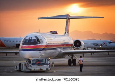 Cagliari, Italy 19/08/2017: Meridiana Mcdonnell Douglas MD80 taxing at sunset