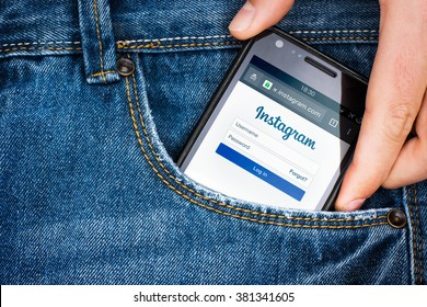 """Cagliari, Italy - 23/02/2016: Smartphone in a jeans pocket with """" Instagram """" login page on screen"""