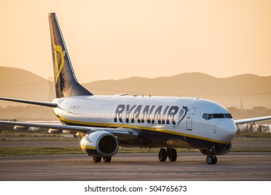 Cagliari Italy, 23/10/2016; Ryanair Boeing 737-800 taxing to the gate at Cagliari Elmas Airport at sunset
