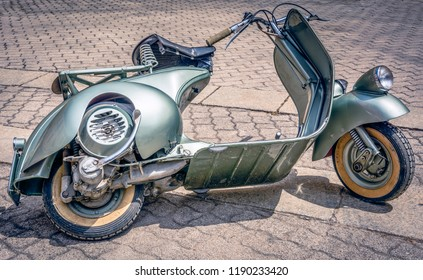 Cagliari, Italy - April 29, 2018: Piaggio Vespa vintage scooters meeting. Vintage Vespa from the 50s. Post process in vintage styl