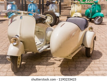 Cagliari, Italy - April 29, 2018: Piaggio Vespa vintage scooters meeting. Vintage Vespa with Sidecar from the 50s. Post process in vintage styl