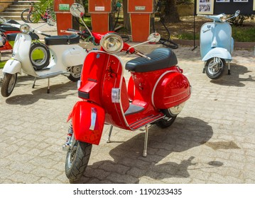 Cagliari, Italy - April 29, 2018: Piaggio Vespa vintage scooters meeting. Vintage red Vespa from the 50s. Post process in vintage styl