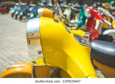 Cagliari, Italy - April 29, 2018: Piaggio Vespa vintage scooters meeting. Vintage yellow Vespa from the 50s. Post process in vintage styl