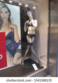 CAGLIARI, ITALY - CIRCA OCTOBER 2019: Yamamay lingerie set with suspender belt and black stockings worn by a mannequin on display for sale