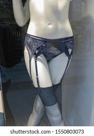 CAGLIARI, ITALY - CIRCA OCTOBER 2019: Yamamay suspender belt and black stockings worn by a mannequin on display for sale