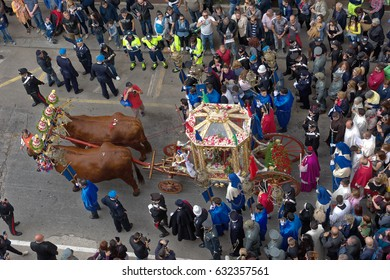 Cagliari, Italy - May 1, 2017: religious procession of Sant'Efisio - Sardinia - Parade of sardinian traditional costumes. Pilgrims from above. / Procession of Sant'Efisio