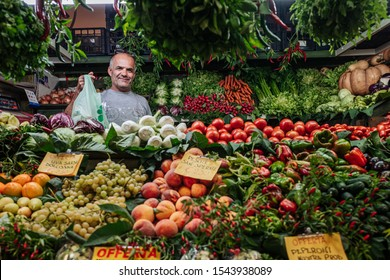 CAGLIARI, ITALY / OCTOBER 2019: Fruits and vegetables vendors at the San Benedetto food market