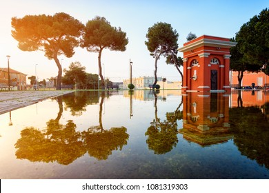 "Cagliari, ""San Bartolomeo"" square with reflections at sunset. Specular landscape with perfect reflection in water."