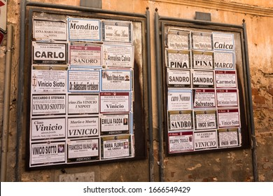 CAGLIARI, SARDINIA, ITALY - SEPTEMBER 26th 2019 : Funeral notices announcing a death on the municipal notice boards. Little posters indicate the name and age of the person who has passed away.