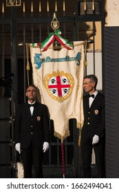 CAGLIARI, SARDINIA, ITALY - SEPTEMBER 29th 2019 : Two men and the sardinian banner, with the green, red and white colours of Italy, a blue band with golden writes of the Autonomous region of Sardinia