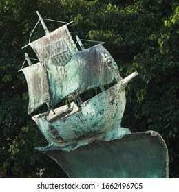 CAGLIARI, SARDINIA, ITALY - SEPTEMBER 29th 2019 : Detail of the bronze sailboat sculpture at the Sanctuary of the Bonaria . It stands high above a big wave.