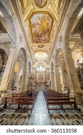 CAGLIARI, SARDINIA - SEPTEMBER 30, 2015: Interior of graceful 1200s cathedral with lavish interior, plus a vast marble pulpit & crypt with royal tombs