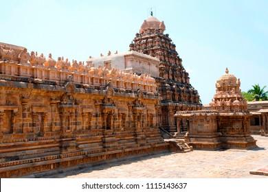 Cahndikesvara Temple on the right and Airavatesvara Temple, Darasuram, Tamil Nadu, India. View from North cloister.