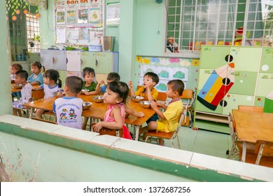 Cai Be, Vietnam - March 7, 2019 -  Young children eating lunch in school  kindergarten in rural Vietnam.