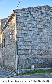 Cailhau Aude France 05/15/19. Old stone building, house. Showing north facing walls protected by large thick slate tiles.