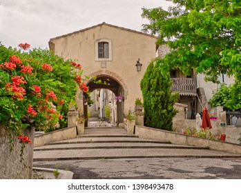 Cailhau Aude France. The arch dated 1568  is gateway into the oldest part of Cailhau. Small alleys lead to the top where there once was a windmill, now a home.