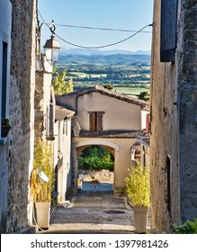 Cailhau, Aude, France, The old arch, dated 1568 stands at the entrance to the orignal village. beyond,  network of narrow alleys lead to a circular stone  house, once a  windmill and to the church .
