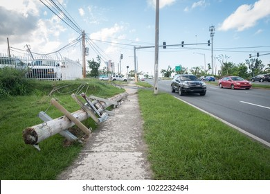 Caimito, Puerto Rico / United States - Dec 2 2017: Amnost three months after Hurricane Maria, the power grid remains broken and in dissaray alongside roads and houses, endangering residents.