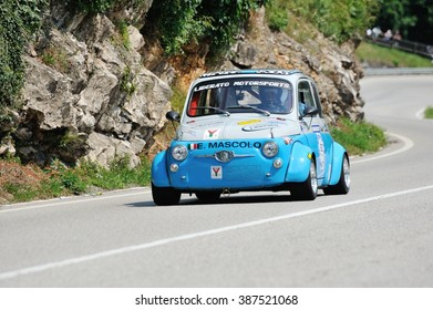 CAINO (BS), ITALY - JUNE 27: A gray and blue Fiat Abarth 595 takes part to the Nave Caino Sant'Eusebio race on June 27, 2015 in Caino (BS). The car was built in 1970.