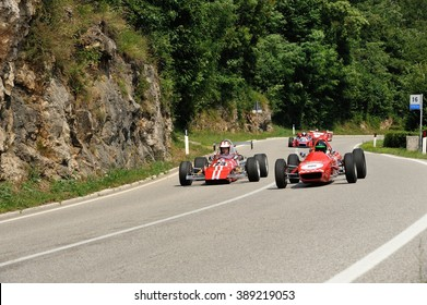 CAINO (BS), ITALY - JUNE 27: A Fagioli Formula 850 follwed by a MRE Formula Ford and other race cars takes part to the Nave Caino Sant'Eusebio on June 27, 2015 in Caino. The car was built in 1968.