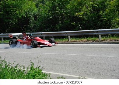 CAINO (BS), ITALY - JUNE 27: A red JCD Dino Formula 2 car takes part to the Nave Caino Sant'Eusebio race on June 27, 2015 in Caino (BS). The car was built in 1975.
