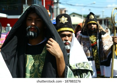 """cainta, rizal, philippines, asia. april 18, 2014. catholic devotees parade dressed in roman costumes as part of the """"senakulo"""". a reenactment of the passion of christ."""