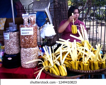 CAINTA, RIZAL, PHILIPPINES - DECEMBER 1, 2018: Vendors sell Suman and local delicacies made from glutenous rice during the town fiesta celebration.
