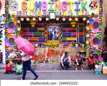 CAINTA, RIZAL, PHILIPPINES - DECEMBER 1, 2018: A store's facade is decorated to celebrate the town fiesta and to promote the local food specialty which are Suman, Bibingka and Latik.