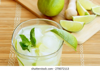 Caipirinha cocktail with limes, white rum, sugar and ice.