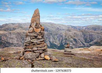 Cairn (a pile of stones) marking mountain hiking trail along the Lysefjord at Kjerag (or Kiragg) Plateau, a popular travel destination in Forsand municipality of Rogaland county, Norway, Scandinavia