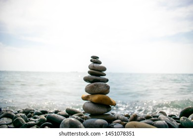 cairn against the sea and sky