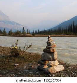 Cairn by an alpine river in the Canadian Rocky Mountains
