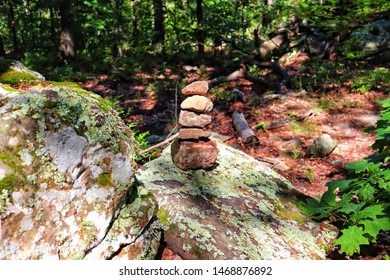 A cairn found on a hiking trail used to mark a path so one can find their way home.