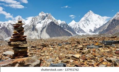 Cairn in the Karakorum Mountains, Pakistan. K2 in the background.